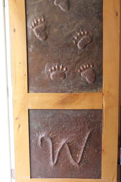 Copper door with bear footprints made at Fenton Inn VA