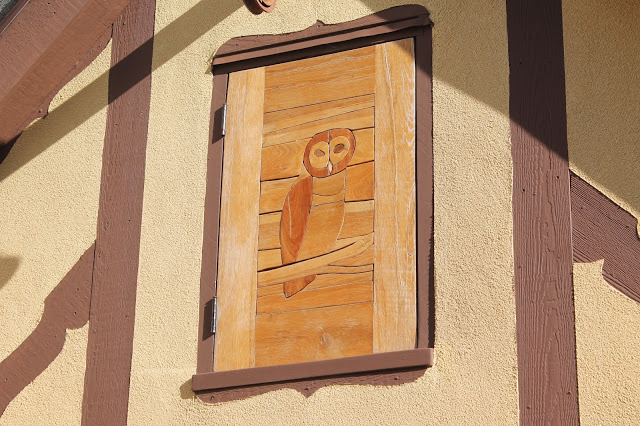 handmade wooden door with owl