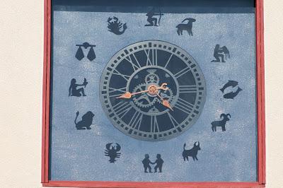 tower clock with zodiac simbols