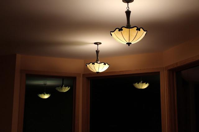 bakery windows reflect lights at night