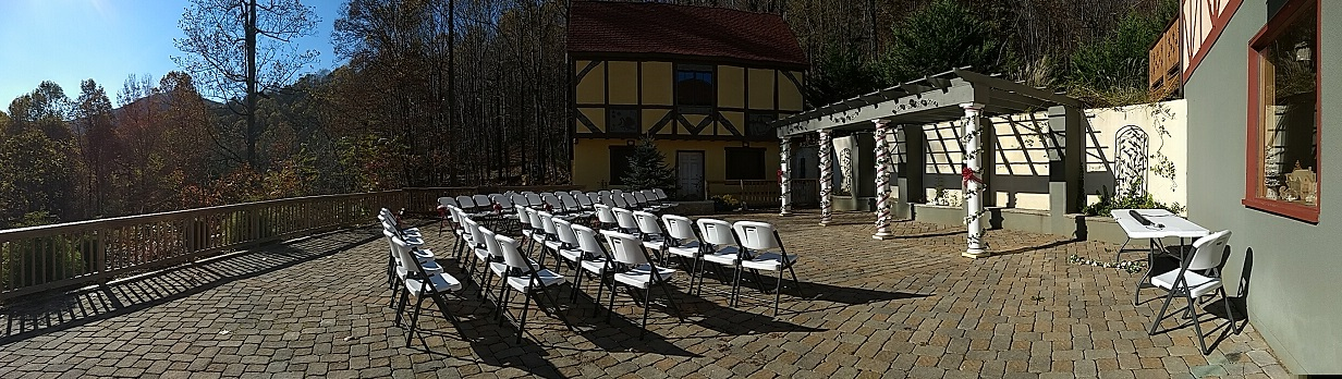 White wedding chairs set up in a rows with white columns and yellow cabin on a background.