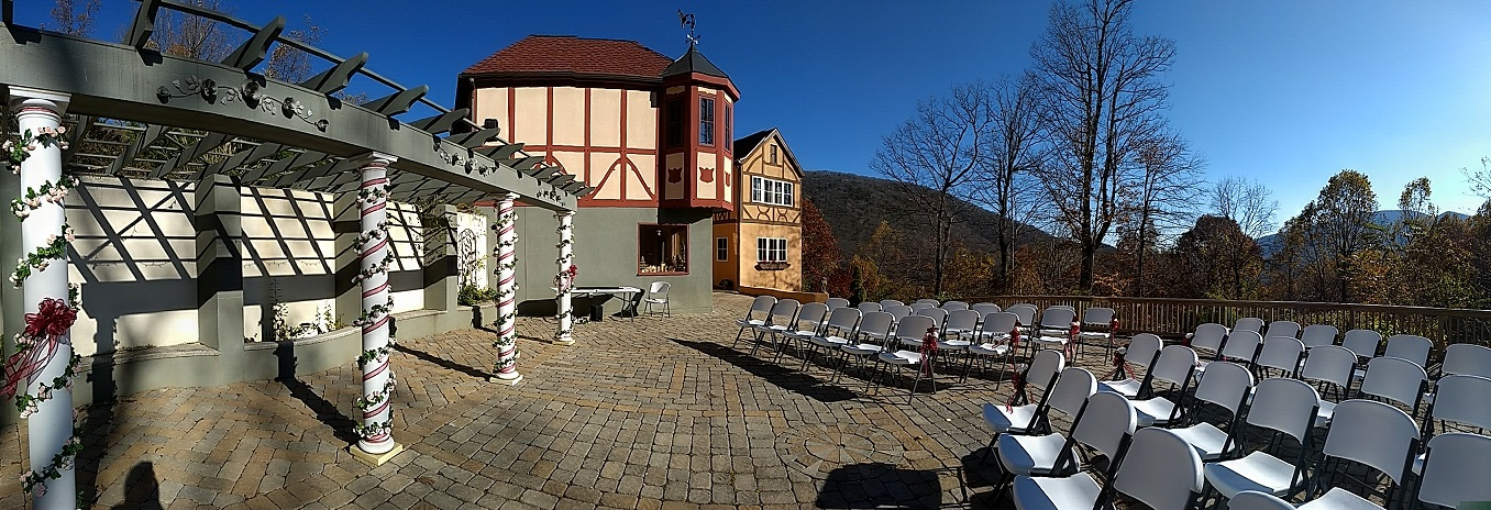 Cobble stone street with white weding chairs set up. Bavarian style village on a background.