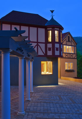 Bavarian style village with a couble stone square that has four white columns.